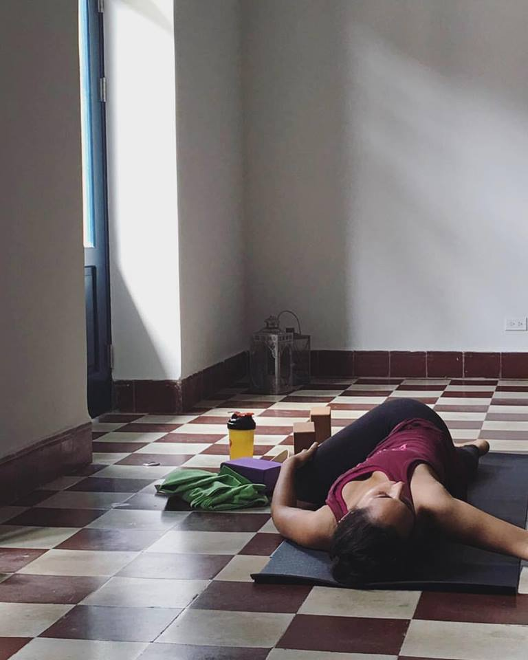 Student in twist in Detox Yoga, Casco Viejo, Casco Yoga, Panama